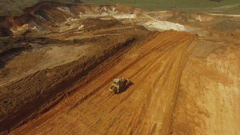 Heavy bulldozer,loading sand, aerial view
