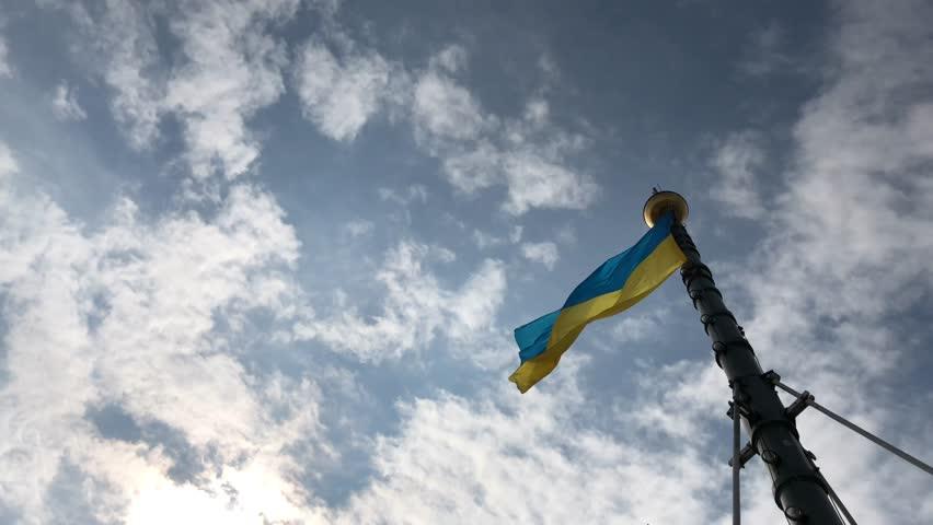 Flag of Ukraine against the sky  | Shutterstock HD Video #1028170493