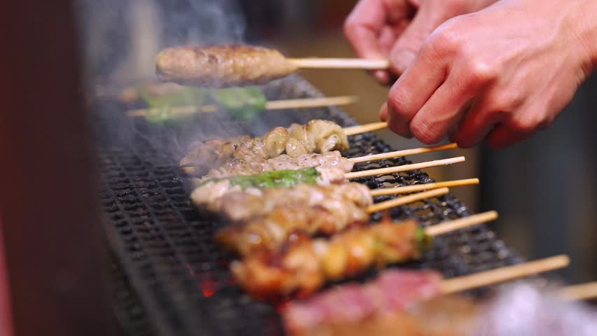 Yakitori translates to grilled chicken and Yakiniku means grilled meat, it's a must have when visiting Japan ! | Shutterstock HD Video #1028222063
