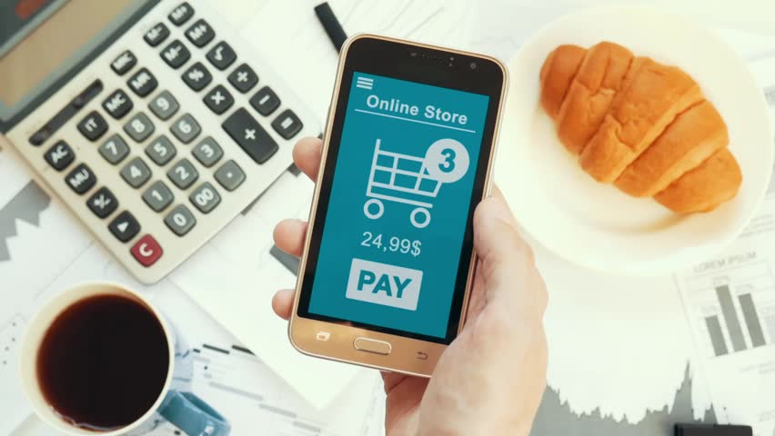 Buying in the online store through the phone during breakfast at work | Shutterstock HD Video #1028255543