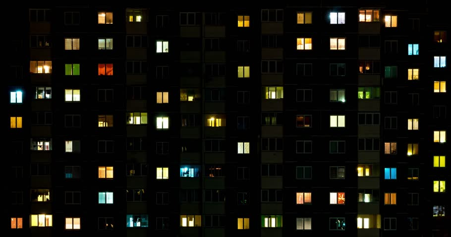 Night time lapse of Light in the windows of a multistory building. life in a big city | Shutterstock HD Video #1028269853