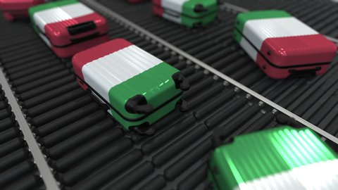 Suitcases featuring flag of Italy move on the conveyor in an airport. Italian tourism related loopable animation