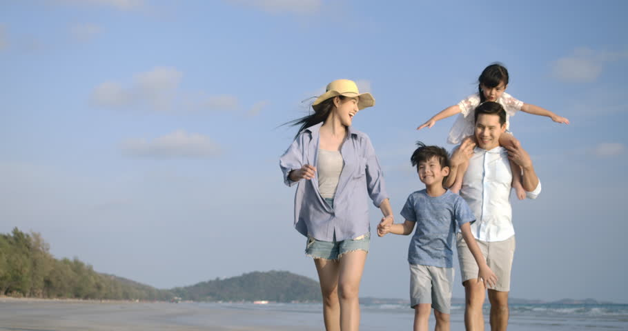 Happy asian family enjoying and walking down the beach on summer vacation. Slow motion. Family, Holiday and Travel concept. | Shutterstock HD Video #1028374733