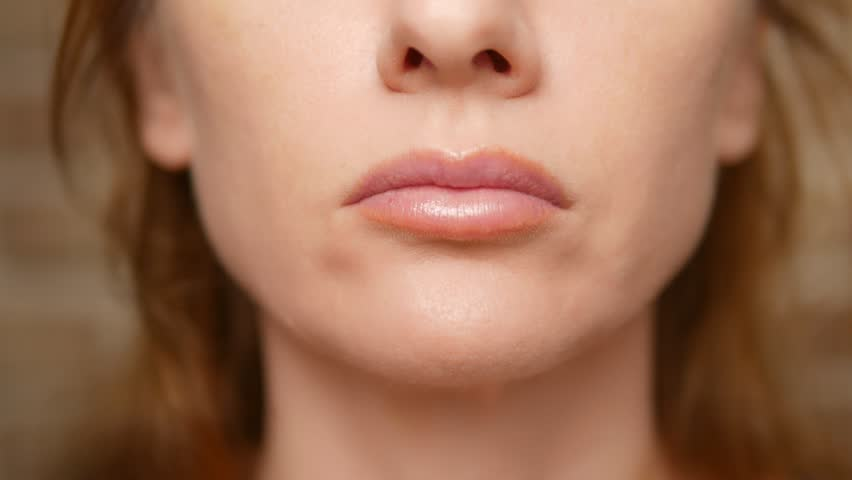 Close up. woman eating hamburger   Shutterstock HD Video #1028388803