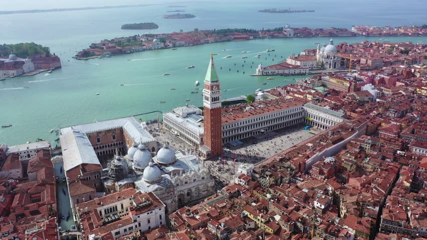 Aerial drone panoramic video of iconic Saint Mark's square or Piazza San Marco featuring Doge's Palace, Basilica and Campanile, Venice, Italy | Shutterstock HD Video #1028401223