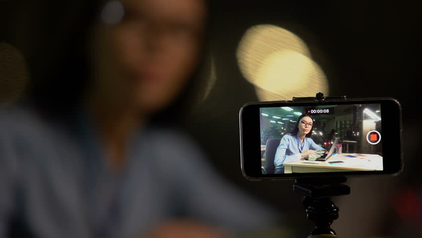 Woman shooting video blog or vlog about making easy money online, advertising | Shutterstock HD Video #1028434103