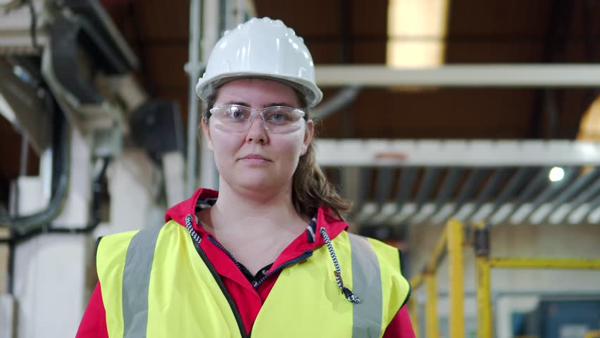 Portrait Of A Happy, Hard Working Woman, Female Industrial Worker In Factory.