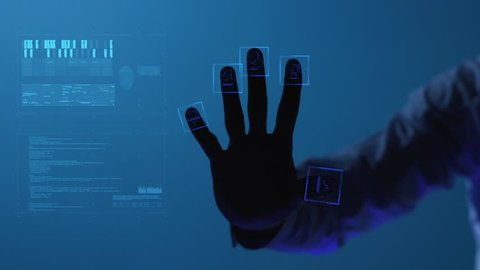 The digital world and technology. For digital applications and solutions. The person clicks on the fingerprint scanner, which is executed in the style of the digital future. Slowmotion. Shot on Arri
