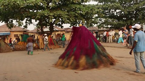 Ouidah, Benin January 9 2015 A day before the voodoo festival you can see the Zangbeto dancing. This voodoo spirit is the watcher of the night and protects cities against burglars and criminals.