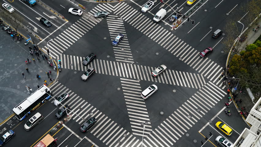 Blur motioin concept.Aerial view car move fast  on pedestrian crosswalk in modern city | Shutterstock HD Video #1028859443