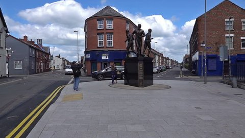 "Liverpool, UK. May 4th 2019. Newly erected statue to commemorate Colin Harvey, Alan Ball and Howard Kendall ""The Holy Trinity"" at Goodison Park, Everton, shot in slow motion 250fps."