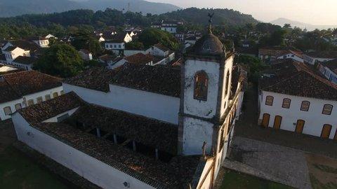 Paraty, Rio de Janeiro / Brazil - 04/25/2019: Aerial view of Santa Rita Church, built in 1722, and houses of the historic center of Paraty