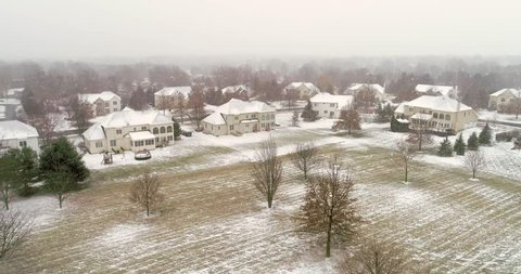 PITTSBURGH, PENNSYLVANIA, US. Aerial 4K view of buildings and trees after snow storm. Snowy conditions in Pittsburgh suburbs.