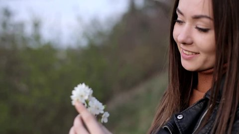 Portrait of a beautiful woman on a forest background, beautiful girl of Tatar appearance