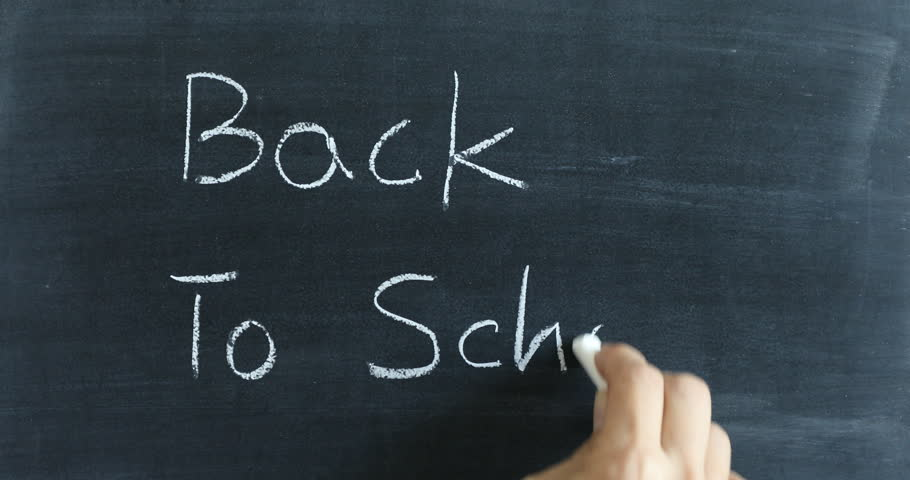 Writing Back To School on chalkboard with white chalk