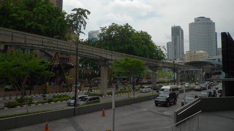 kuala lumpur city center day time traffic street crossroad monorail side panorama 4k malaysia