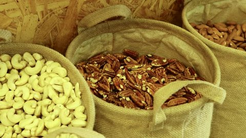 Buying Pecan nuts at the natural food store for a healthy vegan breakfast shake diet