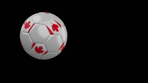 Soccer ball with the flag of Canada flies past the camera, slow motion, 4k footage with alpha channel