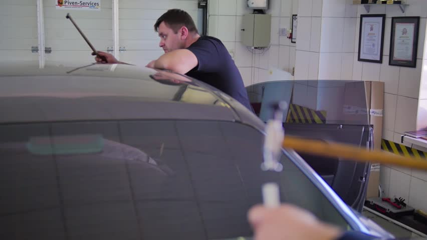 Paintless dent removal. Close up hammer with rubber and machine. Tools for leveling dents without painting. Male master repairs the car in the auto repair shop. Aluminum Hand Tool hammer | Shutterstock HD Video #1029359663
