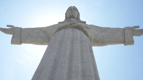 Christ Monument Low Angle Shot. Christ the King is a Catholic monument dedicated to the Sacred Heart of Jesus Christ overlooking the city of Lisbon