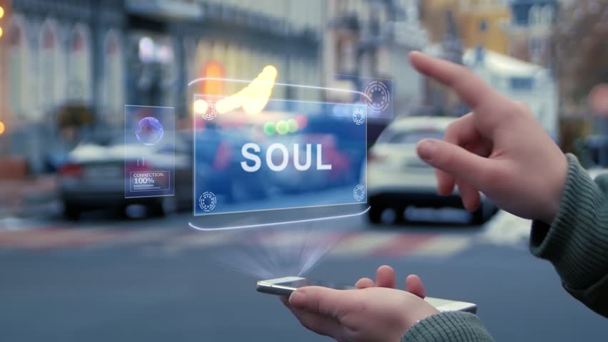 Female hands on street interact with HUD hologram with text Soul. Woman uses the holographic technology of future in smartphone screen on background of evening city | Shutterstock HD Video #1029445463