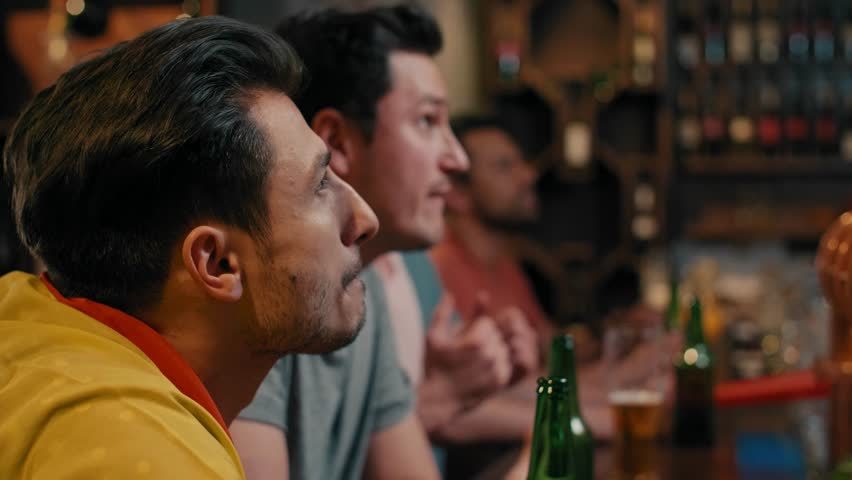 Men cheering their team in the pub | Shutterstock HD Video #1029467753