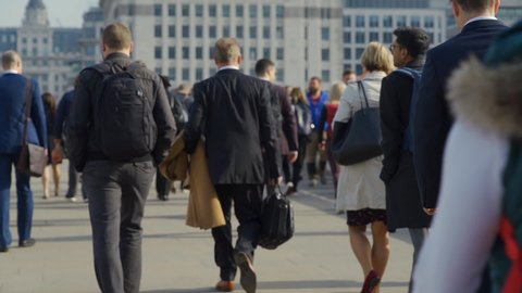 LONDON, ENGLAND - MAY 02, 2019 – Security barrier on London Bridge. Crowd of pedestrian commuters crossing London Bridge on their way to work on cool morning Slow motion version – Clip 56b of 66