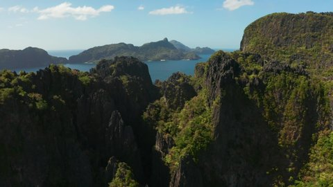 aerial drone of bay and the tropical islands. Seascape with tropical rocky islands, ocean blue water. islands and mountains covered with tropical forest. El nido, Philippines, Palawan. Tropical