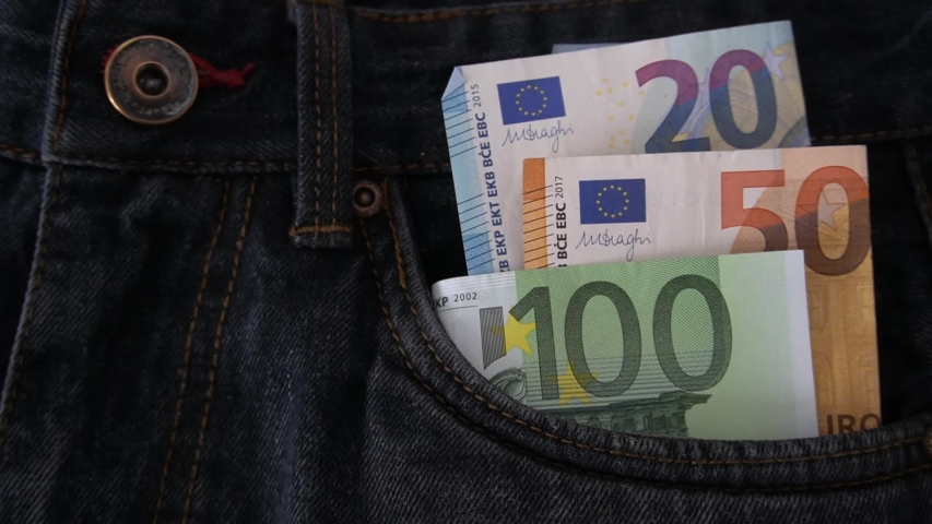 Euro money, 50 euro banknotes in the pockets of jeans trousers | Shutterstock HD Video #1029556943
