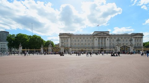 London, UK - June 22, 2018: Buckingham Palace with many people crowded place tourists walking taking photos pictures photographing during summer sunny day with cloudy sky