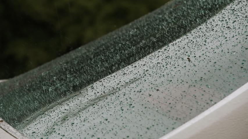 Rear Of The Car. Heavy Rain. Windshield Of The Car Under Heavy Rain.