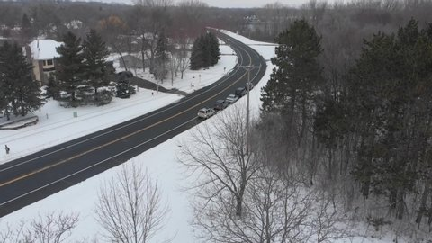 Aerial footage of a freeway in Minnesota during a cloudy winter afternoon
