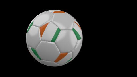 Soccer ball with flag Cote dIvoire - Ivory Coast flies past camera, slow motion blur, 4k footage with alpha channel