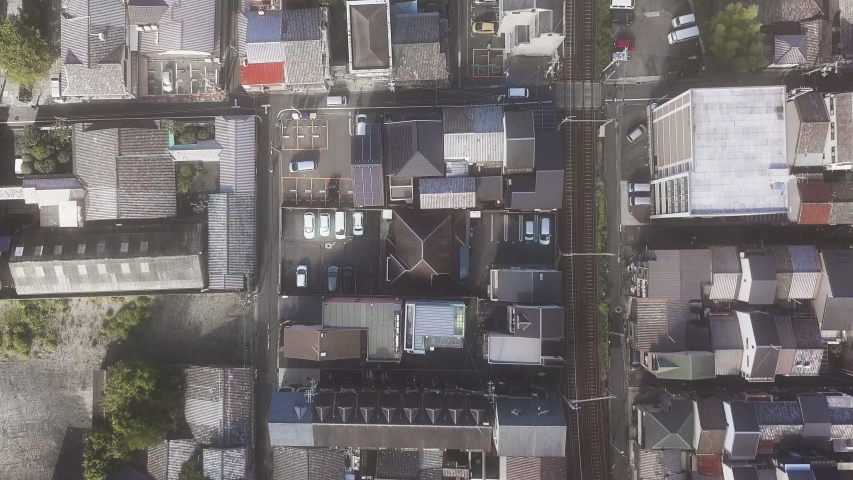 Arial of drone flying and looking down from above over the residential housing area of Kyoto in Japan