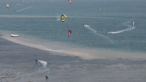 Aerial panorama of kiteboarding activity in Dakhla, Morocco. Slow motion.