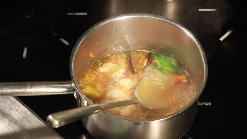 Coocking of Fish Soup with Vegetables in the Pot | Shutterstock HD Video #1029937343