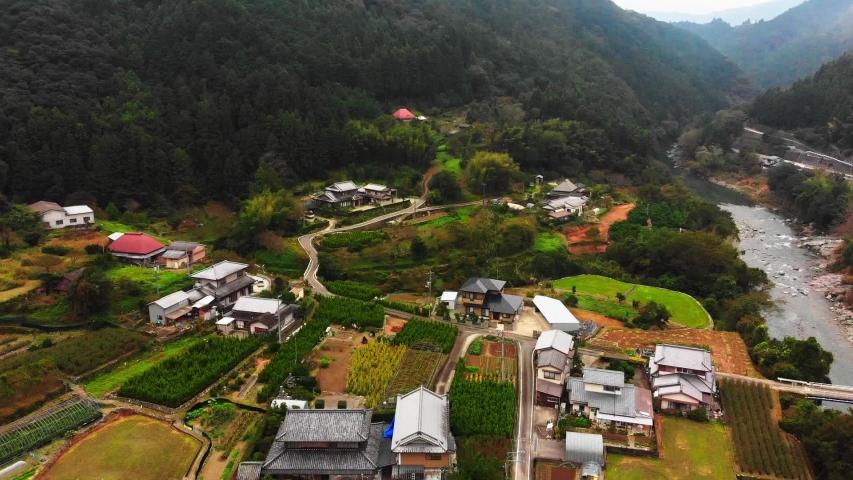 Small village in japan alongside a beautiful river   Shutterstock HD Video #1029961853