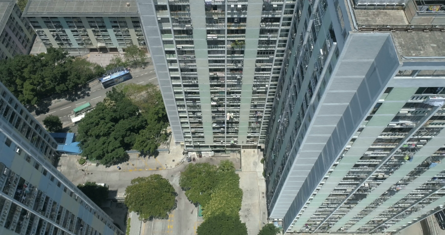 Tall apartment blocks top view. Scenery of overcrowded narrow apartments. Real estate residential building Hong Kong. Modernist mass housing 1960s 4K aerial | Shutterstock HD Video #1029986993