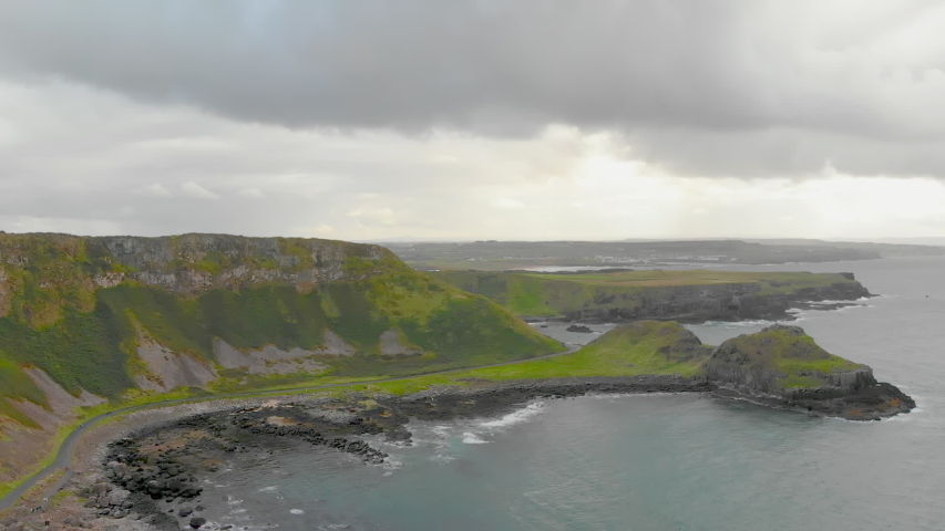 Aerial footage of Northern Ireland's coastline on a cloudy day | Shutterstock HD Video #1030030913