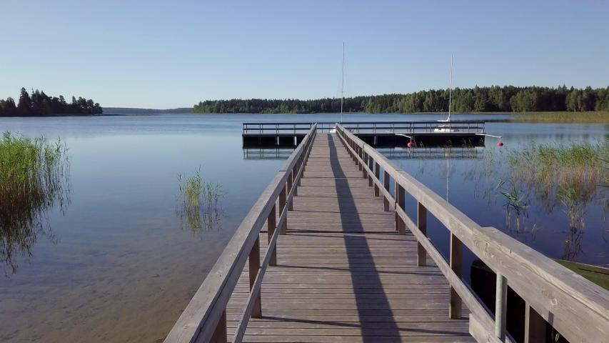 Flight over Lake Plateliai (Plateliu ežers). Aerial of sailing yacht quay in Zemaitija National Park, Samogitia, Lithuania | Shutterstock HD Video #1030083293