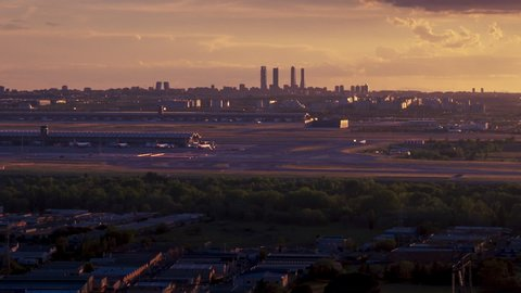 Sunset seen from Paracuellos del Jarama. Timelapse of Madrid skyline with beautiful sunset and impressive storm clouds. Madrid airport and 4 towers bussines area as main subject.