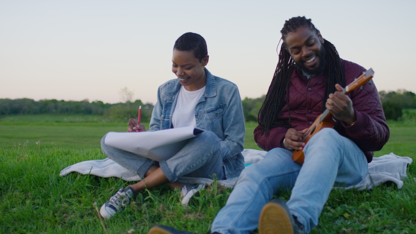 Young black creative couple sitting out in the countryside together, in slow motion   Shutterstock HD Video #1030093523