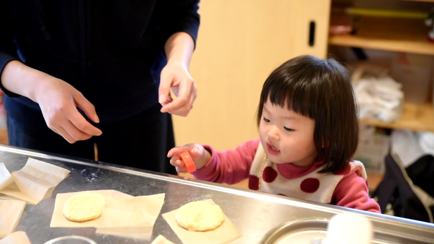 Mother and daughter making donuts   Shutterstock HD Video #1030108853