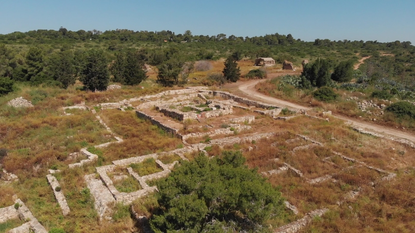 Nature park Ramat Hanadiv. Horvat 'Aleq (Umm el-'Aleq) - excavations, presumably, of the palace of king Herod. (Israel) View from the drone.    Shutterstock HD Video #1030158143
