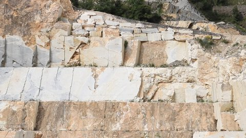 A quarry of Carrara white marble.  The precious white Carrara marble has been extracted from the Alpi Apuane quarries since Roman times.