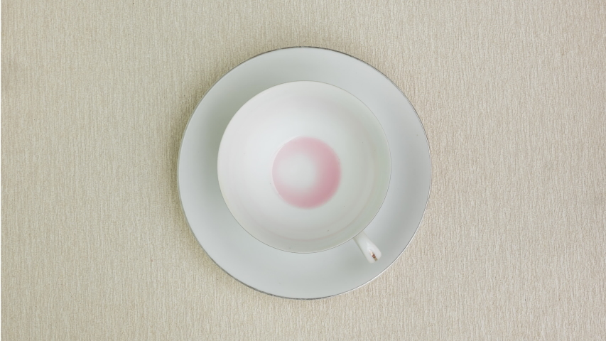 Add strawberry milk to a white cup on brown background, Stop Motion | Shutterstock HD Video #1030179563