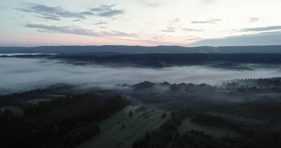 Drone footage of the beautiful foggy landscape. | Shutterstock HD Video #1030240253