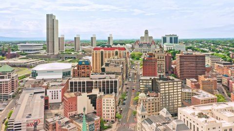 Albany, ny - may 25, 2019: drone footage of albany, new york downtown  the  camera lifts up behind dh building (aka the castle) and reveals the  cityscape along state street