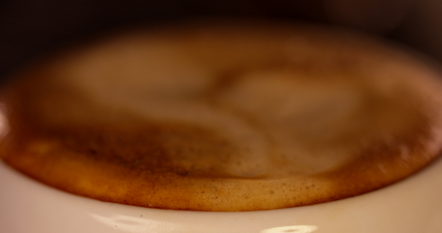 Froth Popping On The Top Of A Mug Full Of Espresso.Italian Roast Coffee Beans. Hot Delicious Beverage. Authentic Coffee Machine. Coffee Shop. Barista Working.Blurred Focus Into Focus   Shutterstock HD Video #1030453313