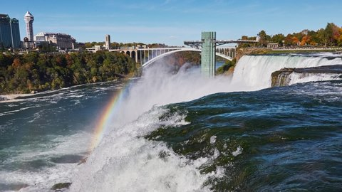 NIAGARA FALLS - OCTOBER 2016: Timelapse of Niagara Falls and amazing nature effect colorful rainbow above the falls in Niagara Falls, New York, USA